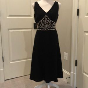 Black cocktail dress with cream embroidery
